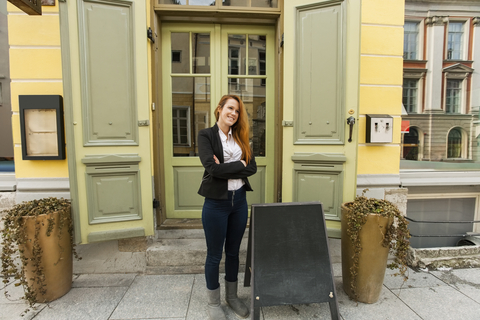 © Photographerlondon | Dreamstime.com - Full Length Of Female Owner Standing Outside Restaurant Photo