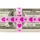 © 18042011e   Dreamstime.com - Stack Of Money Tied Up By Pink Ribbon With Hearts Photo