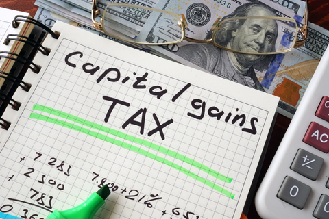 © Designer491 | Dreamstime.com - Notebook With Capital Gains Tax Sign On A Table. Photo