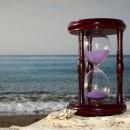 © Gorshkov13 | Dreamstime.com - Hourglass On Sandy Marine Beach Photo