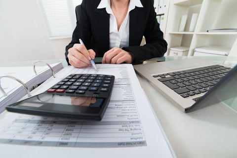 "© Andreypopov | Dreamstime.com - <a href=""https://www.dreamstime.com/stock-photo-businesswoman-calculating-invoice-close-up-calculator-image56849275#res2965056"">Businesswoman Calculating Invoice Photo</a>"