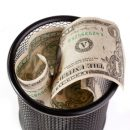 © Yurchyk | Dreamstime.com - Dollars In A Trash Bin Photo