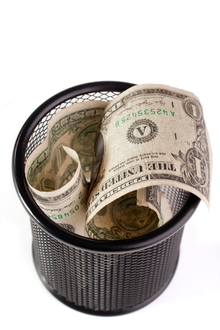 "© Yurchyk | Dreamstime.com - <a href=""https://www.dreamstime.com/stock-photography-dollars-trash-bin-image36437352#res2965056"">Dollars In A Trash Bin Photo</a>"