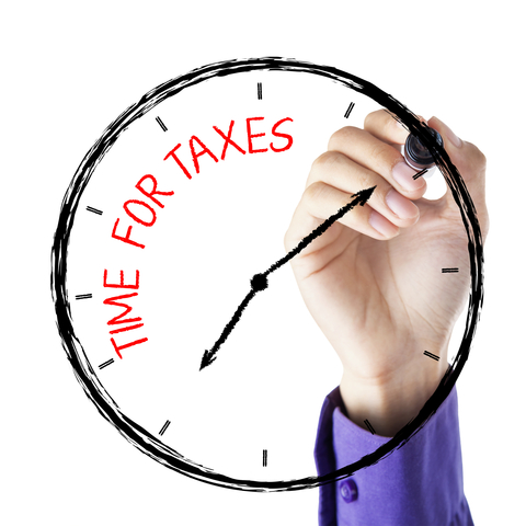 http://www.dreamstime.com/royalty-free-stock-photography-hand-writing-time-taxes-hands-marker-face-clock-image36872907